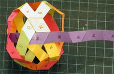 """Modeling a buckyball using an African hexastrip weaving"""
