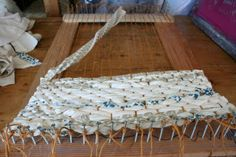DIY rug with fabric scraps and handmade primitive loom.... I like how this looks but how would it get finished off?