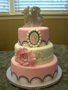 She's A Lady - 10-,8-, and 6-inch round fondant.  Topper and flower are gumpaste.  I saw the half-circle border done by The Pastry Studio, loved it, and finally got the opportunity to use it.
