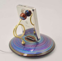 The Handmade Colorful iPhone and iPod Dock Resembles a Lollipop #phonestands trendhunter.com