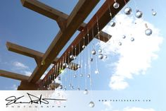 Homemade pergola with crystals where bride & groom were married at their outdoor venue. Crystals Shimmer