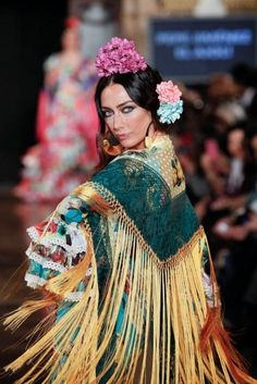 Traje de Flamenca - El-Ajoli  ~ love all the colours and her hairstyle :)