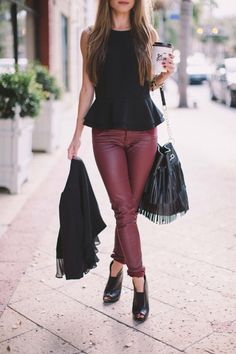 Pair a black fringe bag with a sleeveless peplum top and burgundy coated denim skinny jeans for an edgy chic look. Throw on a cardigan when temperatures start to get cooler for fall. Click through to get inspired from some of our favorite bloggers.