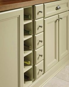 Design racks and small box drawers like these to hold accessories and bottles of wine.