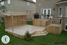 Large, high, two level deck with privacy screen and pergola
