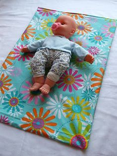 easy homemade diaper changing pads...using a tablecloth!  now I just need to be on the lookout a cute tablecloth on sale