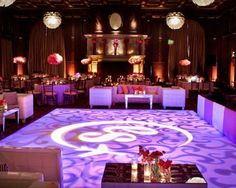 ... when the dancing becomes decor!  Love the party lounge that skirts the brilliantly-lit dance floor.  Smart use of space, theme, furniture rentals and lights.