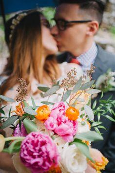 pink and orange bouquet, photo by Veronica Varos http://ruffledblog.com/fallingwater-barn-wedding #weddingbouquet #flowers