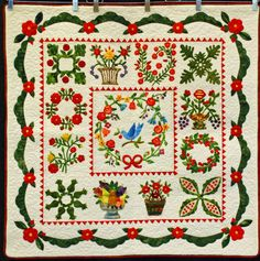 """""""My Little Trip to Baltimore"""" by Patty Henry.  Award, 2013 Boise Basin Quilters Guild show.  Colorful birds and flower baskets were mixed with traditional red-and-green applique motifs."""