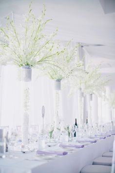 Tall Elegant Centerpiecec by  http://www.PoppysFlowers.com.au/. See more of the wedding on #smp here: http://www.StyleMePretty.com/australia-weddings/2014/04/11/elegant-purple-infused-perth-wedding/ Photography: BenYew.com -- Planner: Cathrin D'Entremont Weddings  http://cdweddings.com.au