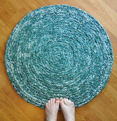fabric strips crocheted into a rug.  totally easy.
