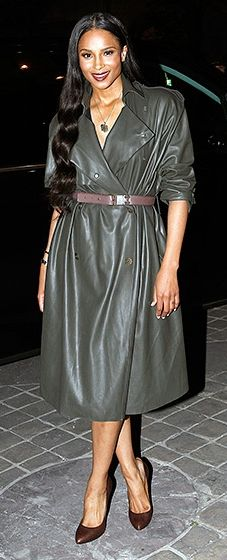 Ciara looked nothing short of sleek in a dark green leather trench paired with brown shoes and a matching belt.