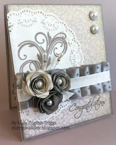 Very classy design using Avonlea papers and Slate polka dot ribbon, Cricut flowers.