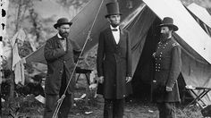 Pinkerton, a former Chicago police detective who founded the Pinkerton National Detective Agency in 1850, foiled an alleged plot against newly elected President Abraham Lincoln as he travelled to his first inaugural. Pictured, Pinkerton (at left) with President Lincoln and General John McClernand, 1862.