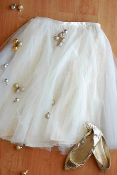 DIY Tulle Skirt - 10 yards of tulle into 5 circle skirts. Stitch onto thrifted/old skirt with zip. Add ribbon.