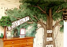 BOY'S BEDROOM: A room-size tree mural, complete with a leafy ceiling canopy and hand-painted board walls, is the perfect spot for a youngster to enjoy all the fun of living outdoors with the comfort of his own private retreat. The woodsy theme includes a lampshade decorated with leaves.
