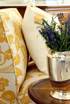 Shows how to add color to a neutral room using fabric and accessories.