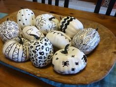 Sharpie Pen Pumpkins made from Dollar Store Pumpkins and hand sketched with full tutorial at thehappyhousie