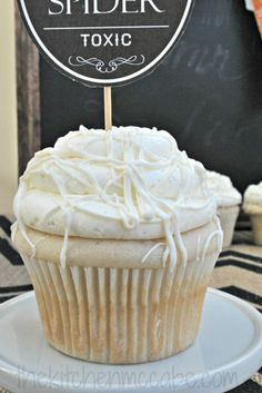 Vanilla cupcakes with white chocolate buttercream spider web topping  Cute Halloween cupcake topper printables