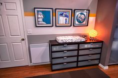 Forget this is a nursery, I would love a robot themed room. Those framed pictures of Bender and R2-D2 are so cool.