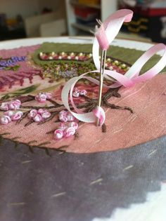 I ❤ ribbon embroidery . . . 2 color petals~ I thought that a variegated silk ribbon with very short segments of white & pink would be great, but I have no such thing, neither have I overcome my dyeing phobia. I could just as well try & thread my needle with two ribbons at the same time. It worked like a charm: as if I had a ribbon that was white on one side & pink on the other. ~By MÁNYA, Humming Needles