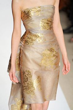 Golden embroidered details  the shape of this nude dress is divine