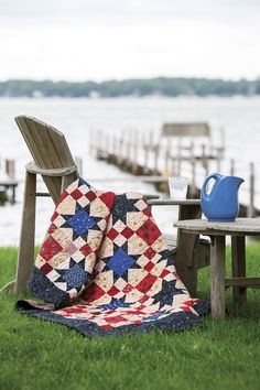 """Kathy Munkelwitz is a veteran Quilts of Valor quilt maker. """"I love stars of any kind,"""" she says. Kathy came up with two simple blocks using her red, tan, and blue fat quarter stash to create this beautiful Quilt of Valor. Look for Of Thee I Sing in Fall Scrap '14."""