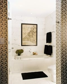 bathroom by celery kemble - tile wall; slab surround and floor
