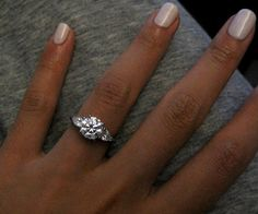 love this ring idea - pear shaped side stones with round center