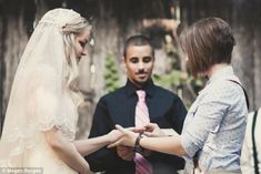 Ceremony: The women, who were married in Arkansas in October, place rings on each other