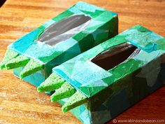 Make dinosaur feet for your kids using empty tissue boxes, tissue paper & sponges. So fun! #crafts #kids #DIY