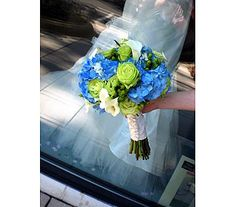 Hand tied bouquet of blue hydrangea, Super Green garden roses, green hypericum berries and white mini callas lilies.