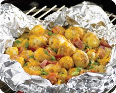 Grilled Loaded baby bakers... a fun play on the classic loaded baked potato that can be easily prepared alongside other items on the grill!