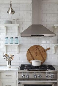 Subway tile with oyster gray grout.