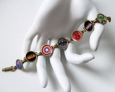 Avengers Assemble! On thy wrist! Brass design featuring Captain America, Thor, Iron Man and the Hulk.