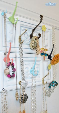 jewelry storage made from old drawer fronts and random hooks and knobs
