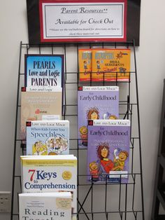 Literacy coach Heather Sisson stores helpful resources for parenting on a rack where visitors and volunteers enter to sign-in.