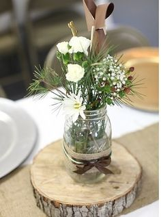 Centerpiece Rustic Chic. @Mandy Bryant Charbonneau this gave e the idea of putting the wood chargers under the candles and jars/vases for the center pieces