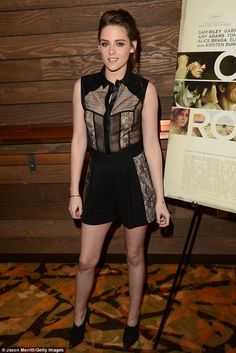 Turning on the glamour: Kristen Stewart has another red carpet fashion hit as she steps out in a ladylike playsuit