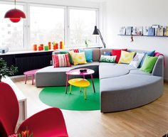 round couch and green floor in denmark.