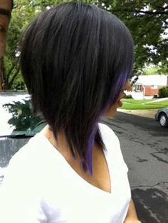 Long inverted bob hairstyle with violet peekaboo highlights.