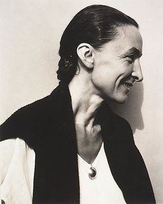 Georgia O'Keeffe - dressed in black and kept her house minimalist in color and content so it wouldn't compete with her focus on her paintings (which were vibrantly colored)