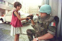 Girl lets soldier pet her kitten