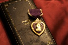 """Purple Heart    The Purple Heart is the oldest award that is still given to members of the U.S. military. It is awarded in the name of the President to those who have been wounded or killed while serving with the U.S. military. The original Purple Heart, designated as the Badge of Military Merit, was established by George Washington. The actual order includes the phrase, """"Let it be known that he who wears the military order of the purple heart has given of his blood in the defense of his home..."""