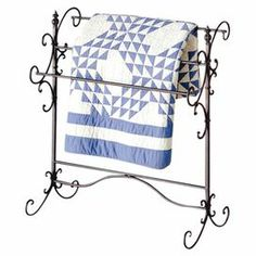 "Display an heirloom quilt or keep cashmere throws on hand with this graceful quilt rack, featuring a black finish with gold highlights and 3 bars.   Product: Quilt rackConstruction Material: IronColor: BlackFeatures:  Three bars for hanging quilts or throws Rustic and graceful styleDimensions: 35.25"" H x 31.5"" W x 16"" D"
