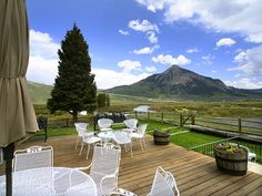 This country home embraces nature's beauty. Imagine relaxing on this handmade deck and looking out at the Colorado mountains and clear blue sky. Crested Butte, CO Coldwell Banker Bighorn Realty $3,500,000