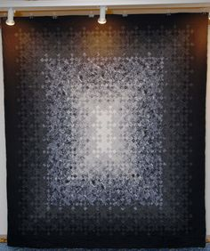 """Light Through Darkness"", a blooming nine-patch quilt by Nora Shafi.  3rd place, pieced bed quilts, Quilts Dubai 2008"