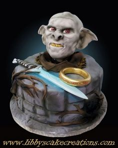 Awesome Lord of the Rings and Hobbit nerdy cake with sword, goblin and ring for geeks