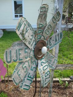 Flower yard art made from license plates and a vintage doorknob - love it! From The Alley To The Gallery: 3 Plates and Some States!