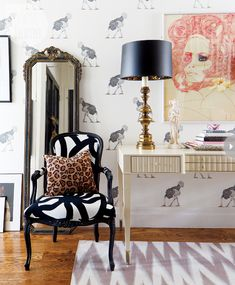 Ostrich wallpaper by Beware the Moon | feminineglam-flirty-style.jpg; Louisesque style chair with up to date upholstered fabric, an antique mirror, fun wallpaper and hollywood regency type console makes this room antique modern.